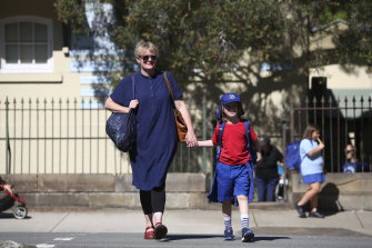 Louise Gough with her son Magnus outside Annandale Public School believes her son is better off at school now than at home.