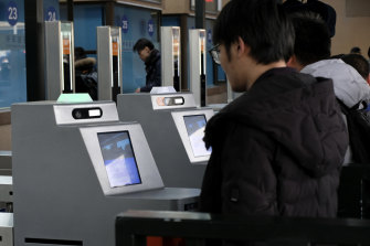 China's monitoring means rail passengers are scanned by face recognition software and are warned over the railway station's PA system to behave or their behaviour will be recorded on their social credit file.