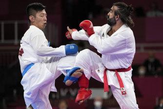 Tsuneari Yahiro of Australia, left, and Rafael Aghayev of Azerbaijan compete in the men's karate kumite on Friday.
