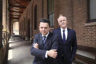 Former independent senator Nick Xenophon and his law partner, former ABC foreign correspondent Mark Davis, outside the Supreme Court in Sydney.