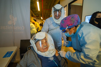 In Bogota in Colombia, the first shot of China's Sinovac is given to a woman aged over 80.