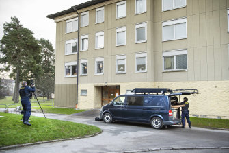Police at the apartment block in Haninge, south of Stockholm, where a woman is suspected of locking up her son.