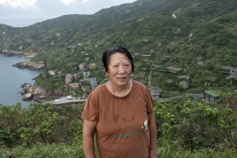 Cai Yaqin, 69, the last villager who moved out Houtouwan Village.