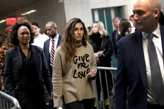 Jessica Mann, centre, arrives at court in New York for Harvey Weinstein's sentencing.