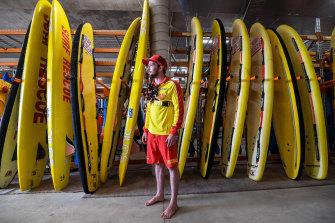 Jameson Trainor with surf rescue equipment at the Jan Juc surf lifesaving club.
