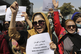 Women gather to demand their rights under the Taliban rule during a protest in Kabul on Friday