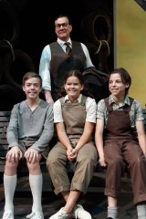 Michael Sparks as Atticus Finch with (sitting l-r)  Jamie Boyd as Jem, Jade Breen as Scout and Jake Keen as Dill on the set of To Kill a Mockingbird.