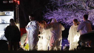 Law enforcement near the area where a suspect in a series of bombing attacks in Austin blew himself up.