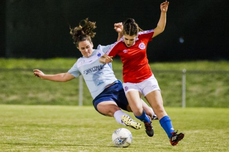 Belconnen's Karen Clarke tackles Canberra FC's goal-scorer Diarna Genovesi.