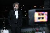 Florian Zeller being interviewed after his Oscar win in April.