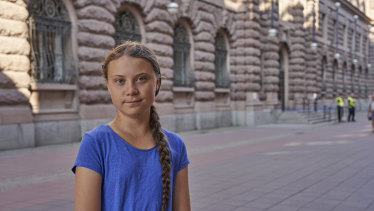 Climate activist Greta Thunberg stands next to Swedish parliament in Stockholm on Friday. The teenager often travels by train in Europe and will now sail to the US.
