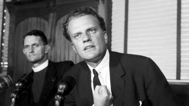 """""""""""People will be talking about religion - some badly, some against it, but that is good. It shows people are interested."""" Dr Billy Graham pictured at a press conference in Sydney on 10 April 1959."""