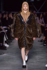 A model wearing a hoodie that has been slammed for having a 'noose' cord in the Burberry show at London Fashion Week.