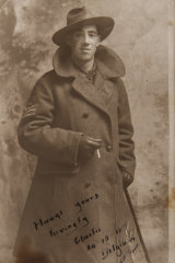 A portrait of Idris Charles Pike with monocle, cigarette and greatcoat.