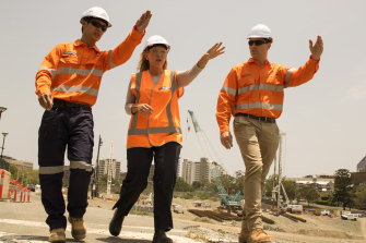 Kate Jones (centre) took over as Cross River Rail Minister last year.