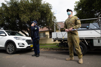 The Police and ADF conduct checks in Lakemba to see if people are home who are meant to be in isolation.