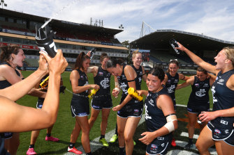 Carlton players celebrate after they defeated the Cats at Ikon Park on Sunday.