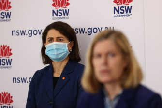 NSW Premier Gladys Berejiklian (background) and Chief Health Officer Dr Kerry Chant (foreground) on Tuesday.