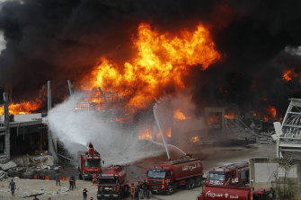 Firefighters battle to extinguish a huge blaze at the Port of Beirut on Thursday.
