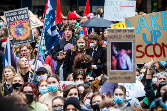 School students walk out of classrooms to demand action on climate change.