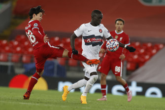 Awer Mabil, right, jostles for possession with Liverpool's Takumi Minamino.