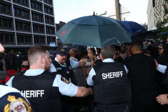 Sheriffs intervene after a scuffle breaks out outside the court.