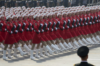 A Chinese military honour guard marches during the the celebration in Beijing on Tuesday.