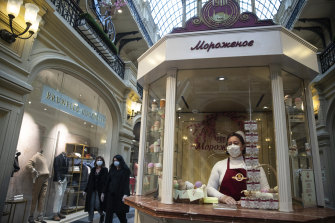 An ice-cream seller waits for customers at a department store as Russia began reopening on Monday.