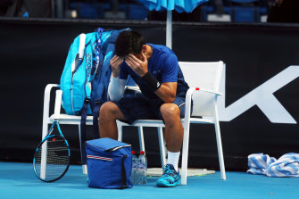 Japan's Yuichi Sugita after retiring from his men's singles match due to injury.