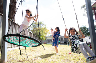 Amina Youssef-Shalala with her daughters, from left, Antoinette, Celine and  Lucia in their Sydney backyard.