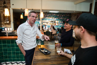 NSW Treasurer Dominic Perrottet has a beer at The Balmain Hotel on Friday as pubs are allowed to open to 10 diners.
