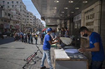 Palestinians line up to buy bread during a 48-hour lockdown.