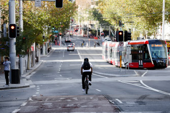 George  Street's car-free  zone is to be extended further south in a government trial.