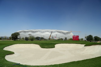 The stadium, pictured in the background, is one of several being built in Qatar ahead of the 2022 World Cup.