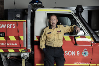 Former prime minister Tony Abbott pictured on Sunday in his role as a volunteer firefighter.