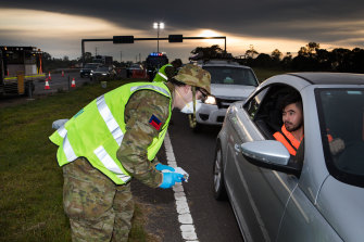 The defence forces checking drivers on the Geelong highway on June 10.