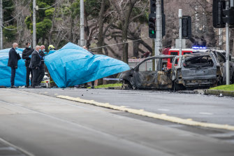 Police at the scene of the fatal crash on Flemington Road, Parkville.