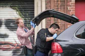 Police raid a property on Lalor St, Port Melbourne on Wednesday morning.