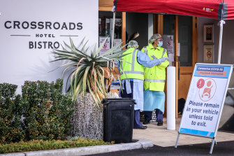 Medical staff at a pop-up COVID-19 testing clinic in Casula in NSW, where the local Crossroads Hotel is now a hotspot.