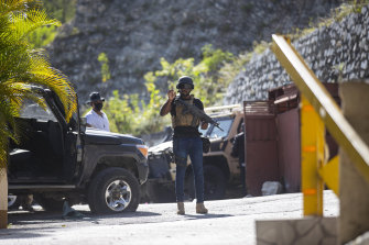 Guards patrol the entrance to the residence of Haiti's President hours after his fatal shooting.