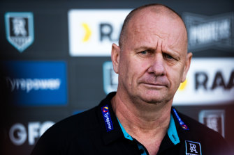 Port coach Ken Hinkley is not happy with the AFL's hotel arrangements for the Crows and the Power.