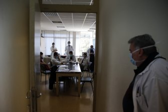 The medical students attend a morning meeting with the doctors at Sotiria Hospital's pathological clinic.