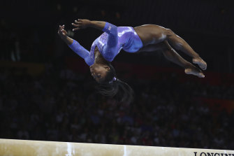 Simone Biles competes in beam final during day 10 of the Gymnastics World Championships in Stuttgart on Sunday.