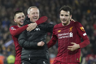 Stand-in coach Neil Critchley celebrates with Pedro Chirivella and Adam Lewis after the final whistle.