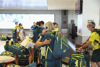 Members of the Australian Olympic team arrive at Sydney Airport.