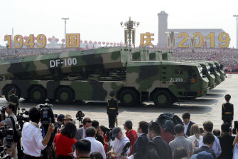Military vehicles form part of an honour guard to mark the 70th anniversary of communist China.