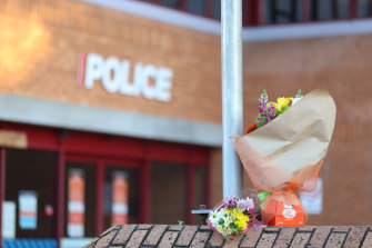 Flowers are left outside the Henderson Police station after an officer was killed on Friday.