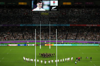 'Respectful distance': Owen Farrell is seen smiling on the big screen during the haka.