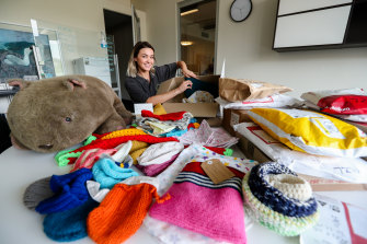 Jenn Rhodes from WIRES with crafted wildlife pouches that have been donated.