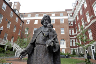 A Jesuit statue is seen in front of Freedom Hall at Georgetown University. In 2016, the university moved to give admission preference to descendants of slaves owned by the Maryland Jesuits as part of its effort to atone for profiting from salve sales.